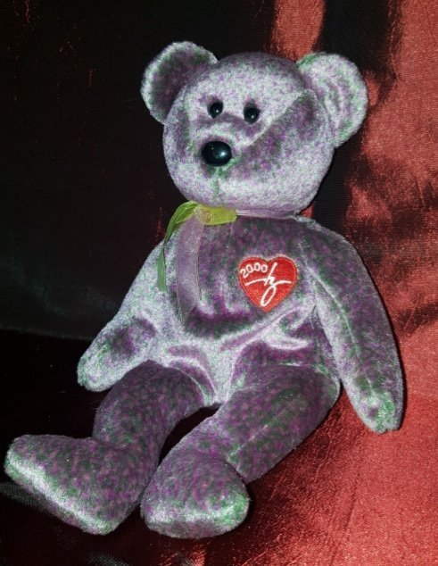 Collectible TY 2000 (purple) 8 ½ inches