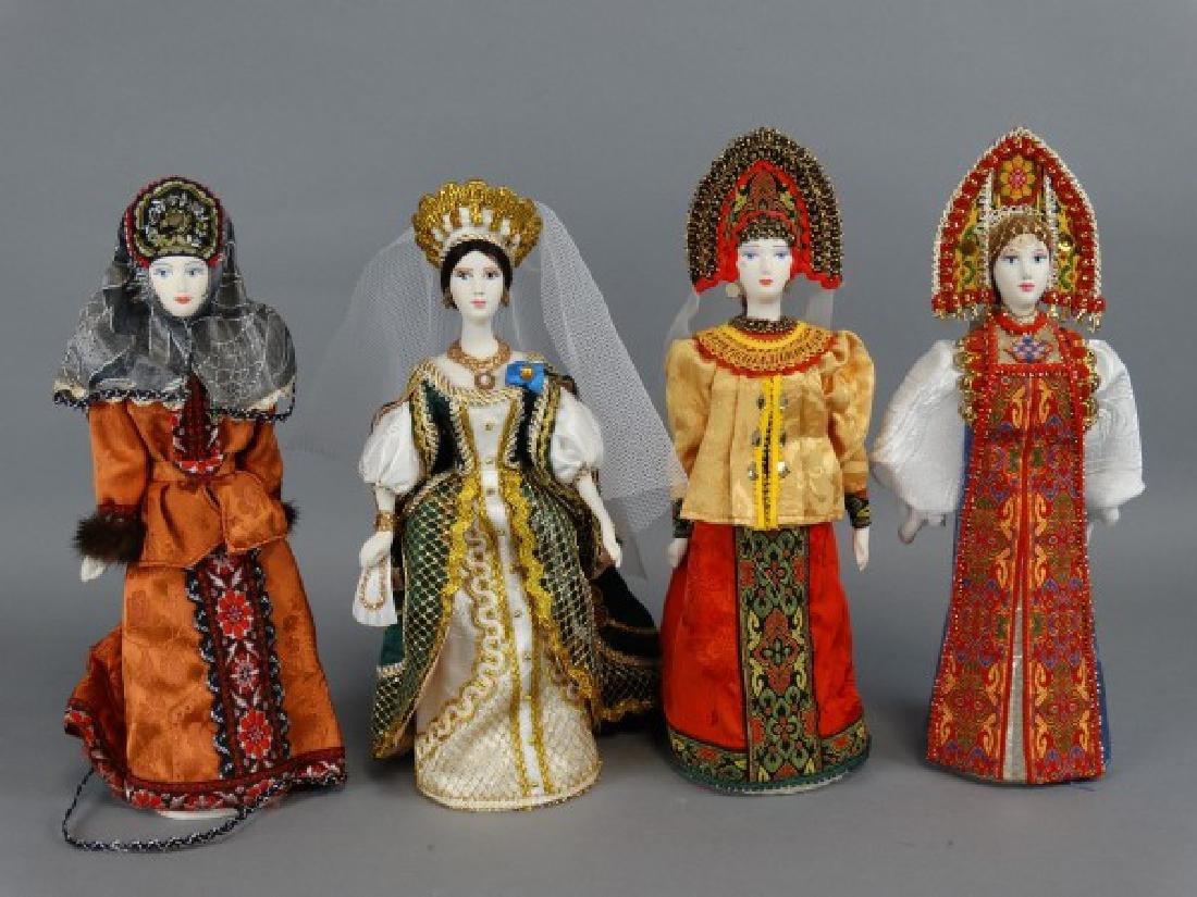 Lot of 4 Russian Porcelain Dolls