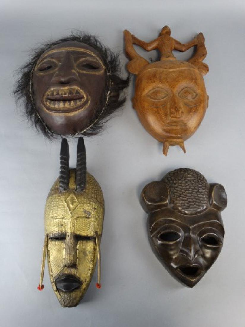 Group of 4 Wooden Ethnographic Masks