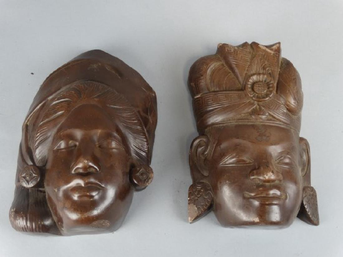 Pair of Carved Stone Masks