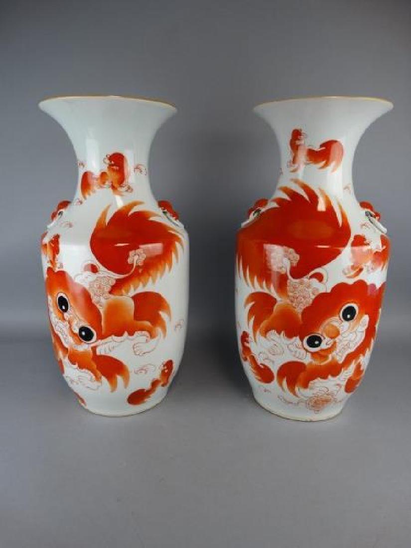 Pair of Red Underglazed Fu Lion Vases