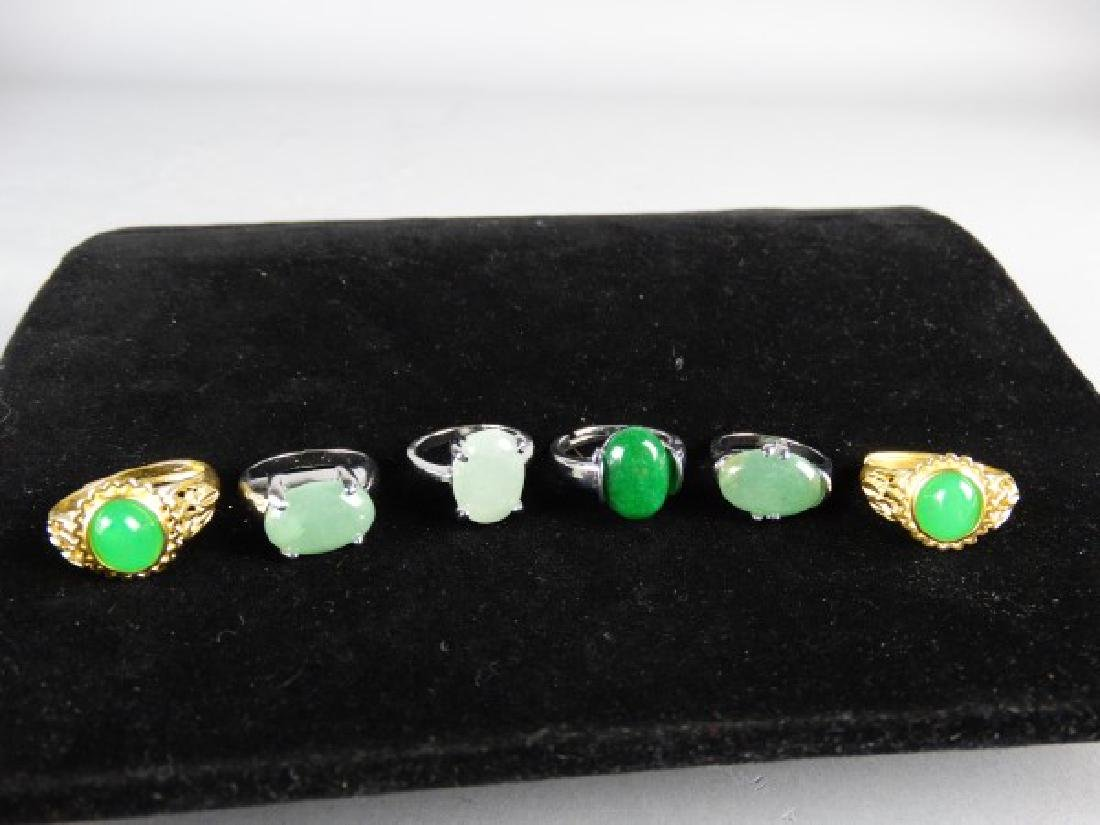 Grouping of 6 Jade Mounted Rings