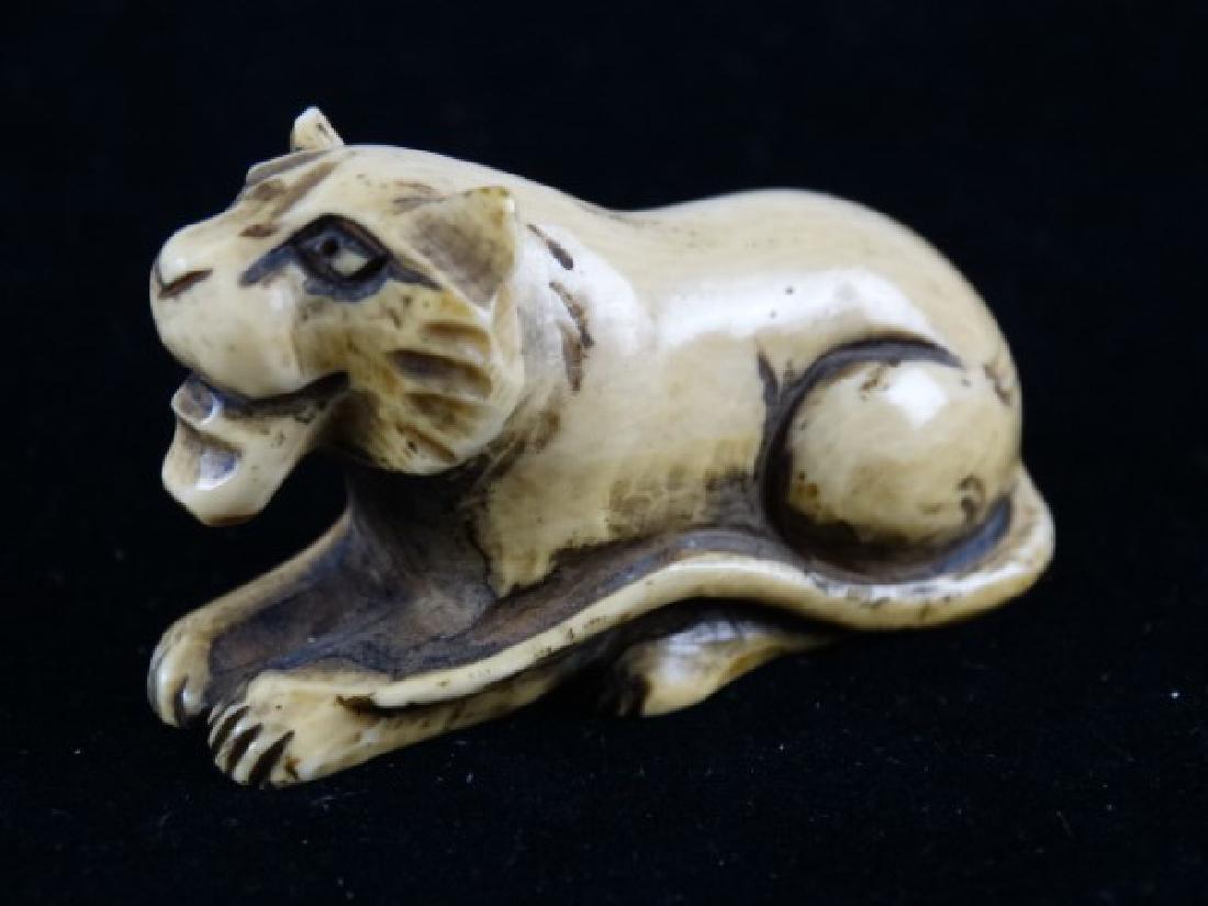 Carved Netsuke - Lion, signed