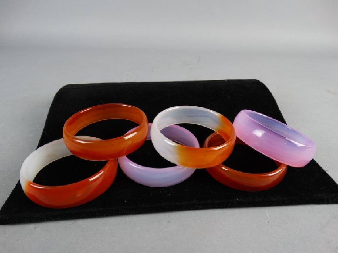 Group of 6 Carved Agate Bangles