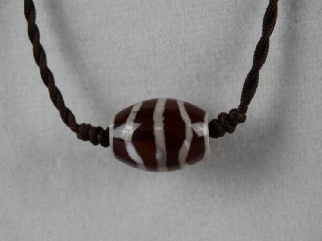 Tibetan Dzi Bead on a Cord - 3