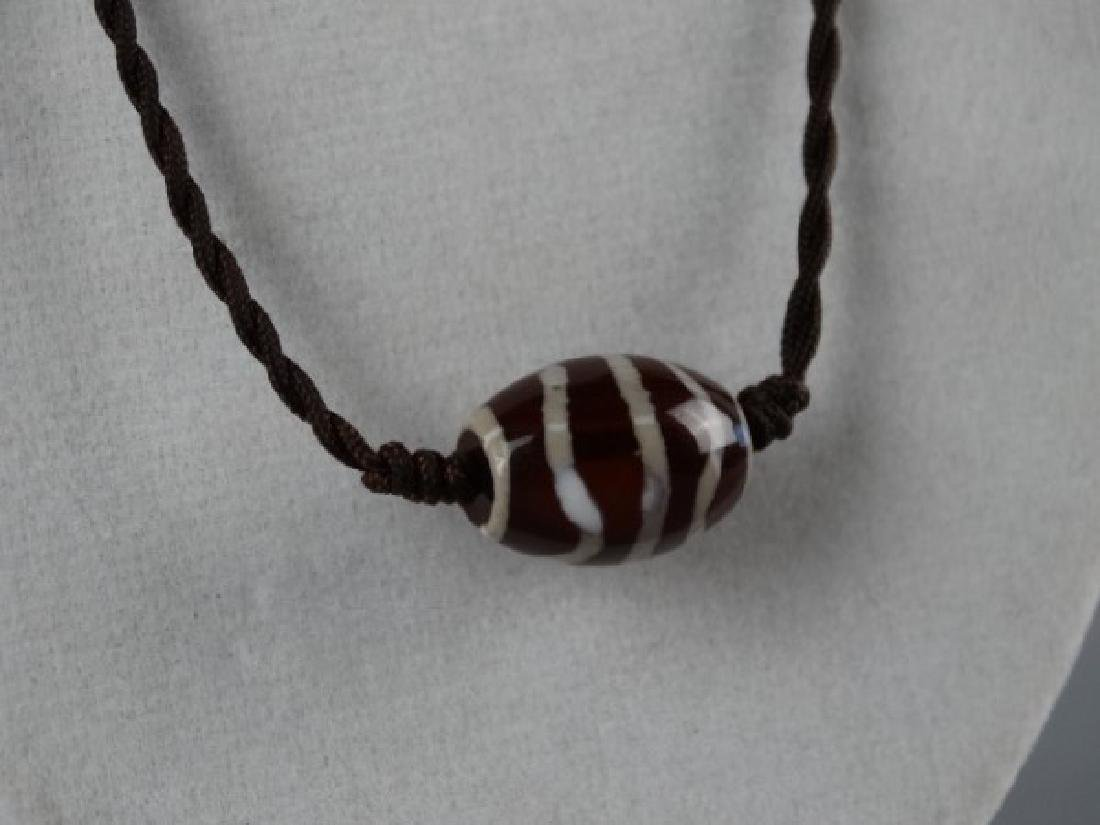 Tibetan Dzi Bead on a Cord - 4