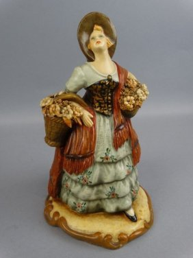 Pottery Figurine Of A Lady With Baskets