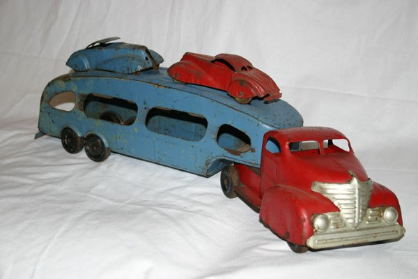 4: ANTIQUE METAL CAR HAUL TRUCK AND TRAILER WITH 2 CARS