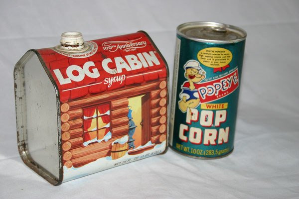 15: LOG CABIN SYRUP CAN AND POPEYE POPCORN CAN