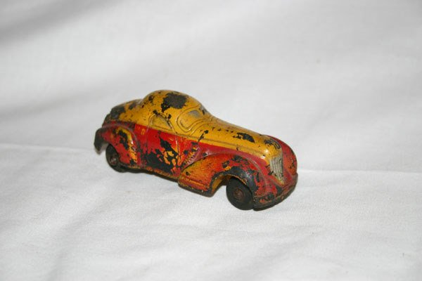 23: HARD RUBBER TOY CAR, SUN RUBBER COMPANY, YELLOW AND