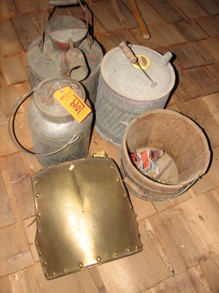 1019: 1 GAS CAN, 2 MILK JUGS, SOME BRASS, BODY ARMOR AN