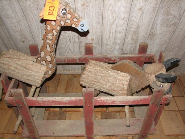 1023: ONE GIRAFFE AND ONE DONKEY BOTH MADE OF LOGS AND