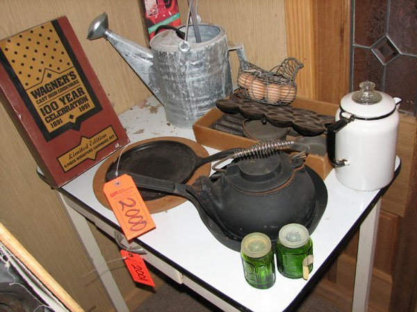 2000: CAST IRON SKILLET, TEAPOT, A GALVANIZED WATERING