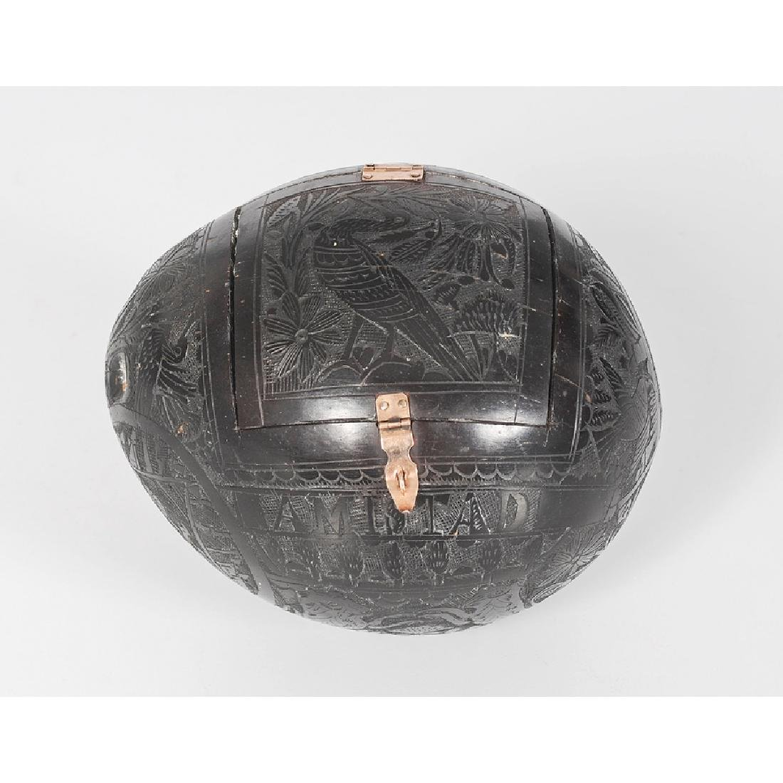 Carved Coconut Bank with Gold Settings