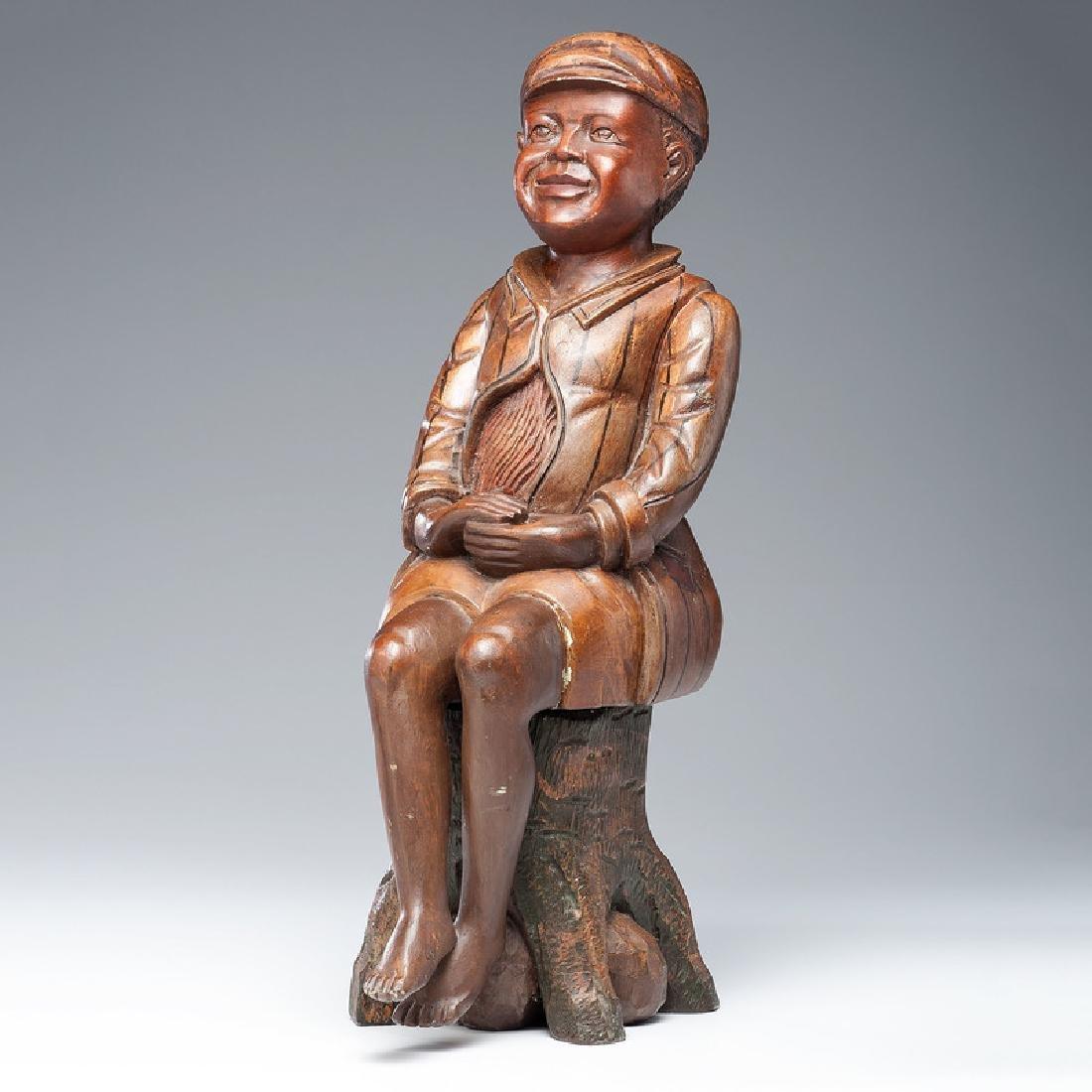 Folk Art Sculpture of a Seated Boy