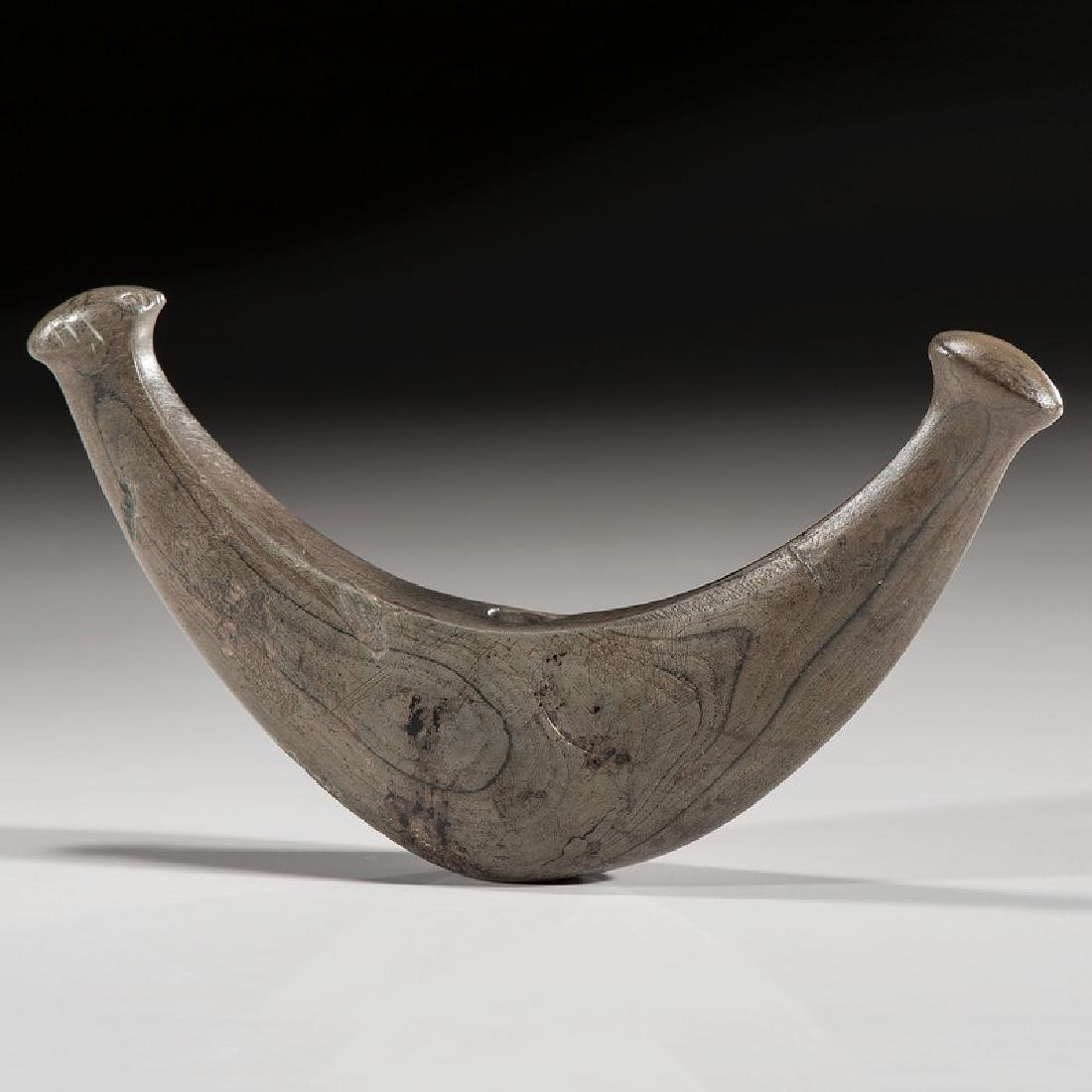 A Knobbed Crescent Bannerstone, From the Collection of