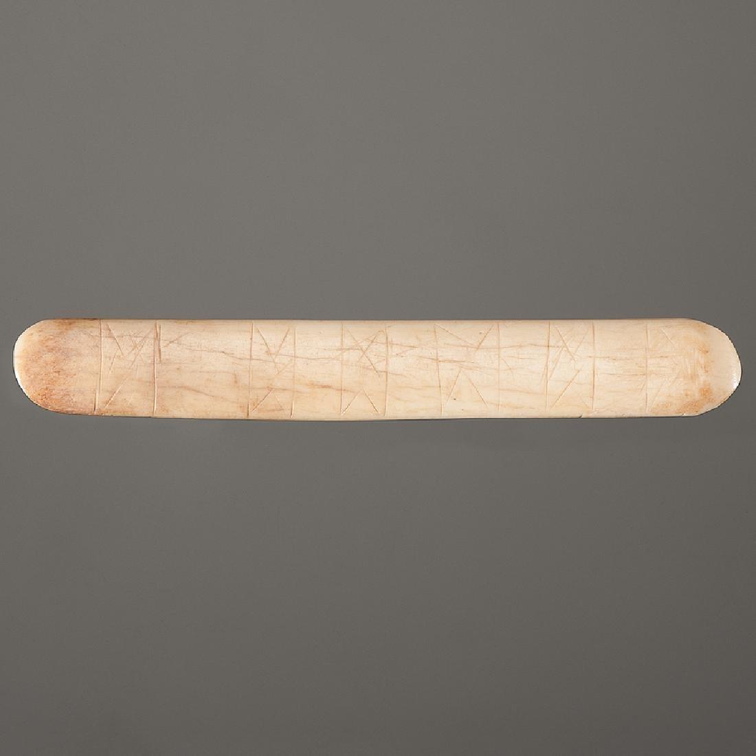 An Engraved Bone Spatulate Tool