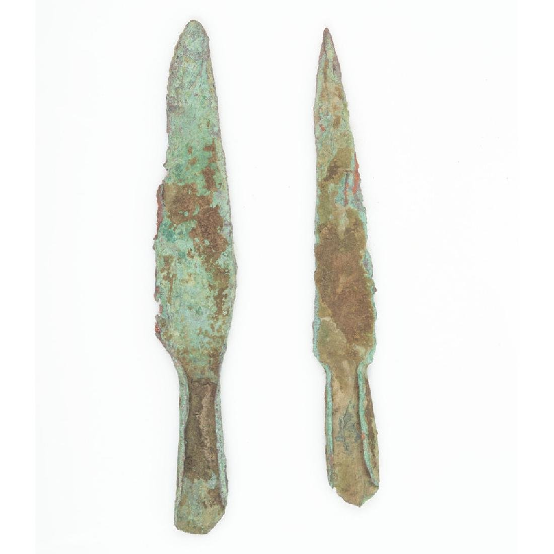 A Pair of Old Copper Culture Socketed Spear Points,