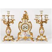 A Louis XVstyle Gilt Bronze and Porcelain Garniture