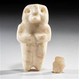 A Pair of Mississippian Human-Owl Anthropomorphic
