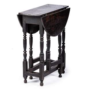 A William and Mary Black Painted Oak Gate-Leg Table...