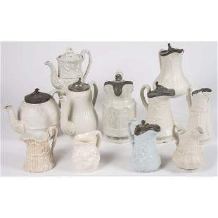 Eleven Staffordshire Salt Glaze and Ironstone Pitchers