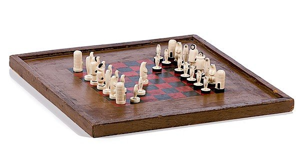 19: Eskimo Carved Ivory Chess Figures with Board