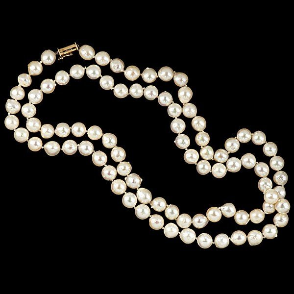 7: Strand of 8mm Semi-Baroque Pearls