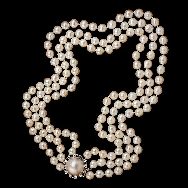 20: Triple Strand of Cream Semi-Baroque Cultured Pearls