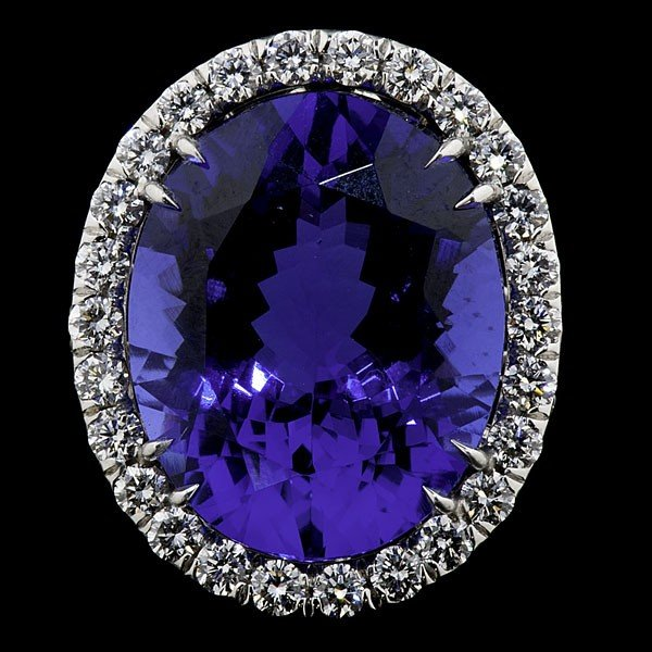 95: 18K White Gold Oval Tanzanite and Diamond Ring
