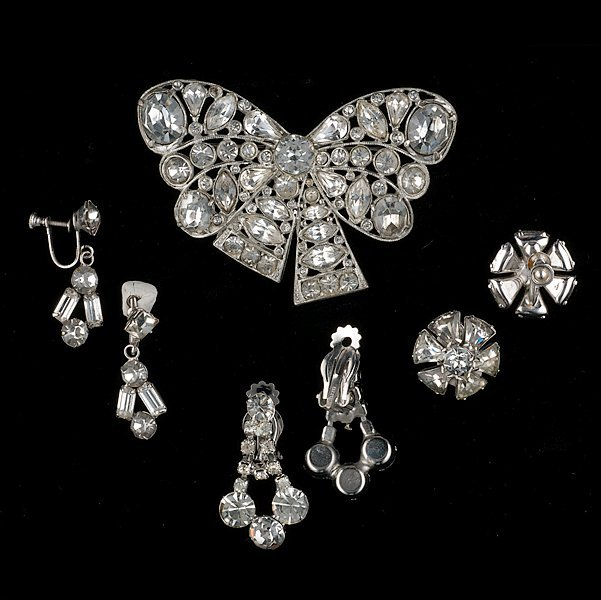 7: An Unsigned Brooch and three pair of ear clips