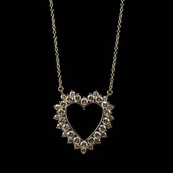 10: Tiffany & Co. 18k Diamond Heart Pendant