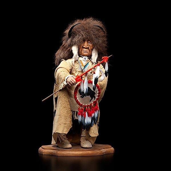 12: Shona Hah Kwakwaka'wakw Carving of a Buffalo Hunter