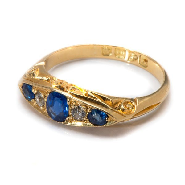 Ladies 18 Karat Yellow Gold Hand-Carved Sapphire and