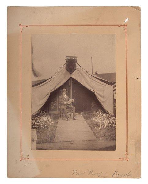 Buffalo Bill Cody Reading Outside His Tent