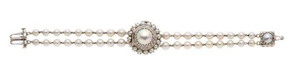 A Vintage 14 Karat Lucien Piccard Pearl Bracelet Watch