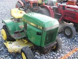 59: John Deere 318 L&G Tractor w/ Mower