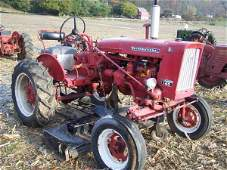533: Farmall 140 Tractor with Woods Belly Mower
