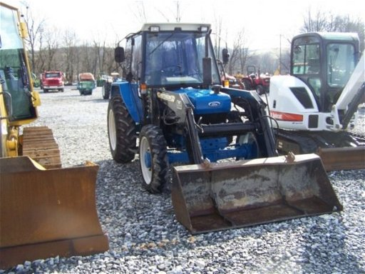 1140: Ford 3930 4x4 Tractor with Cab and Loader