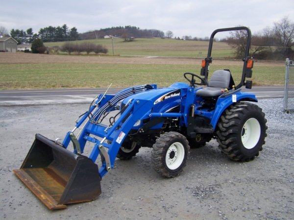 1179: New Holland TC29DA 4x4 Compact Tractor with Loade