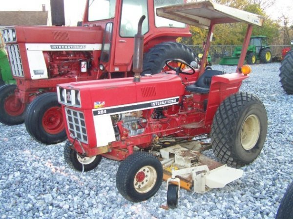 1485: International 284 Compact Tractor with Woods Bell