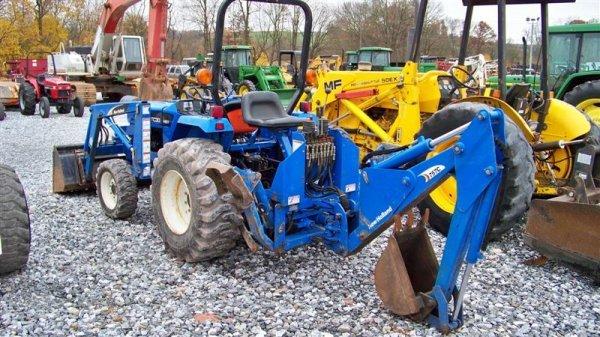 1257: New Holland TC30 4x4 Tractor Loader Backhoe - 4