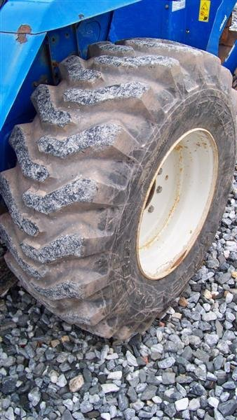 1257: New Holland TC30 4x4 Tractor Loader Backhoe - 9