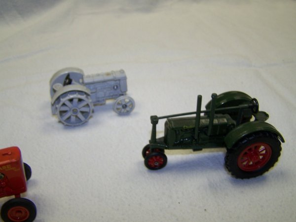 2: Ertl Mini Toy Tractors Ford, Case, and Massey Harris