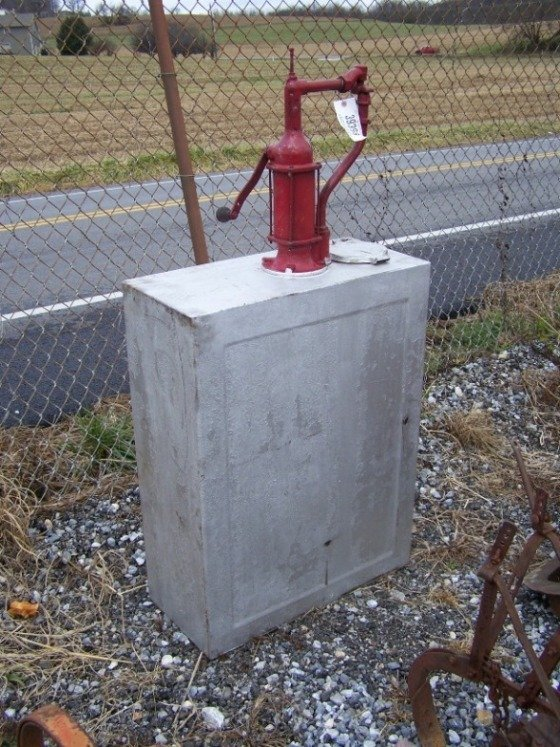 2058: Antique Oil Tank with Pump