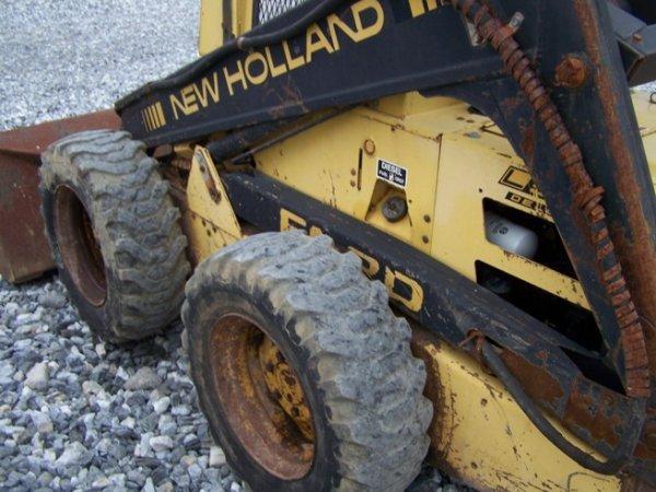 147: New Holland L555 Skid Steer Loader with OROPS - 10
