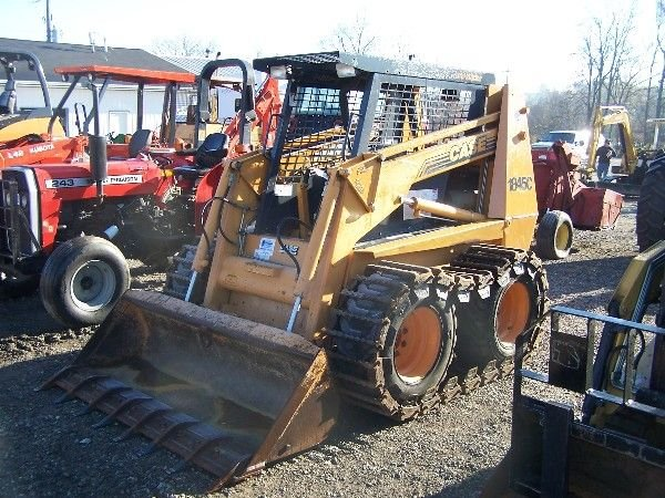 26: CASE 1845C SKID STEER W/ BUCKETS AND TRACKS