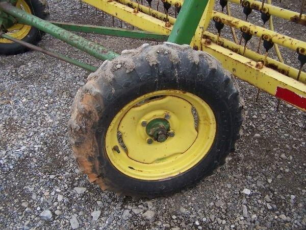 19: John 660 Hay Rake with Dolly Wheel