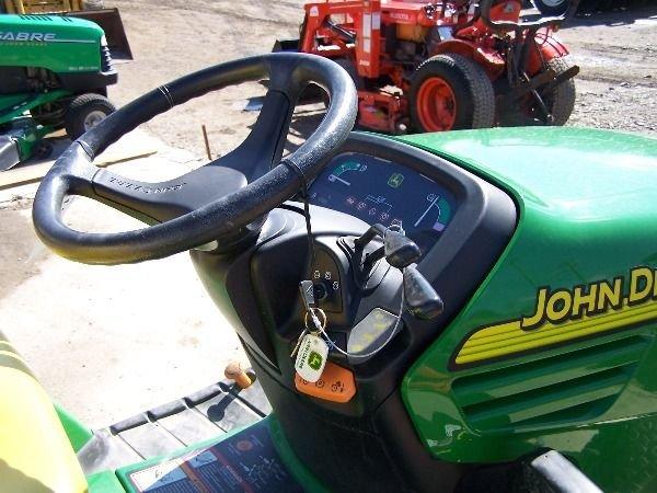 75: John Deere X585 Lawn and Garden Tractor w/ 4x4 Mowe - 10