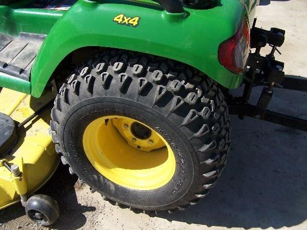 75: John Deere X585 Lawn and Garden Tractor w/ 4x4 Mowe - 4